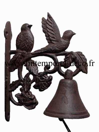 Cloche oiseaux et fleurs en fonte
